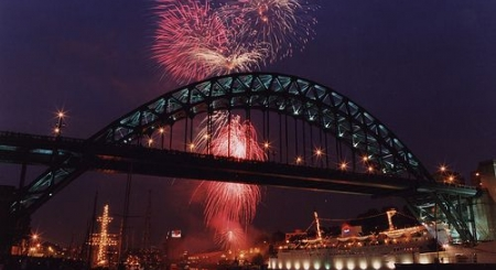 a picture of fireworks behind the Tyne Bridge